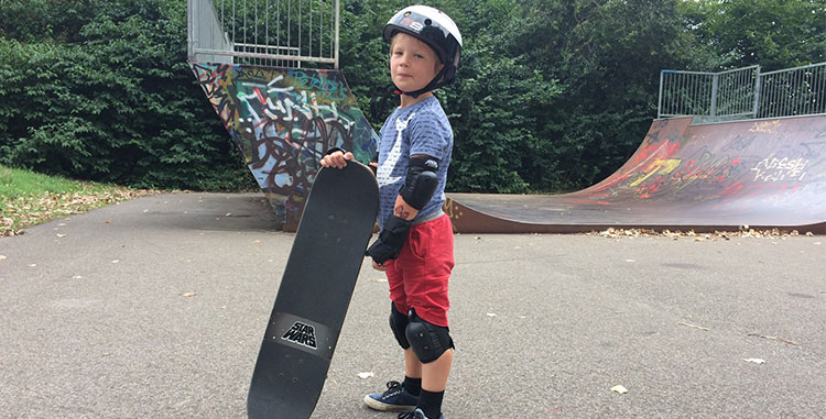 kid wearing protective skateboard gear